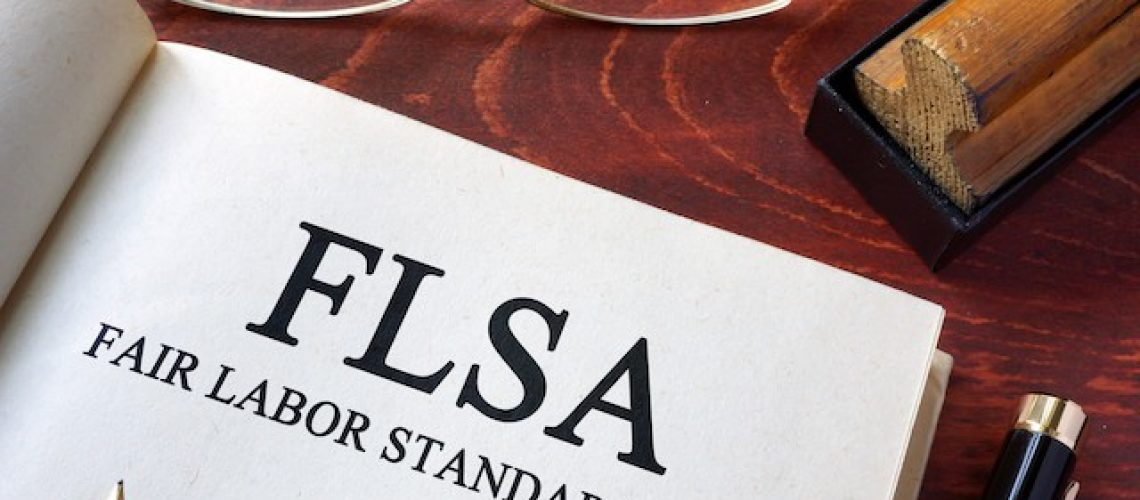 Page with FLSA fair labor standards act on a table.